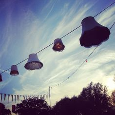 Lanterns at Secret Garden Party - vintage lamp shades over party lights. Great idea!