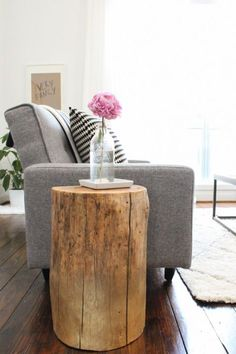 clean lines, grey and brown, the pop of pink, the DIY stump end table. basically everything.