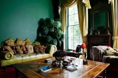 Green Room Design Ideas. Richly deep and dark - jade green walls, olive leather tufted sofa (with enough pillows for a fight!)... all that's missing is a book - and some shelves.