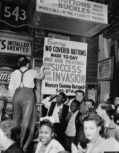 A New York haberdasher fixing up a sign explaining that his shop will be closed while staff pray for Allied victory in the invasion of Normandy on D-Day, June, 6 1944. (FPG/Hulton Archive/Getty Images)