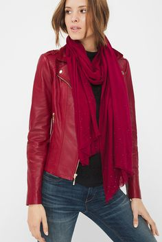 Our red studded oblong scarf is a top layer that will make everything in your closet just a little bit cooler. Be bold and pair it over our leather moto jacket. White House Black Market | Holiday Style