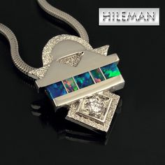 Australian opal inlay pendant in 14 karat  white gold accented by a 10pt. diamond.  $1950.00