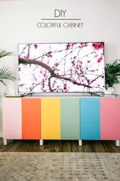 colorful cabinet DIY. This besta Ikea hack will make your rainbow home decor dreams come true! This TV stand idea is complete with interior styling. Click through to read the full tutorial