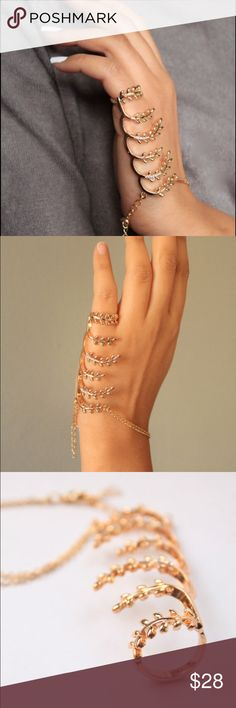 Gold Palm bracelet Gold connected bracelet.                                        Ring size: 5.25                                                         Material: copper, gold plated Jewelry Bracelets