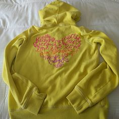 Victoria's Secret PINK yellow hoodie M Such a cute hoodie! Previously loved but cared for well. Only missing hood drawstring. I love it, it's just small on me. PINK Victoria's Secret Tops Sweatshirts & Hoodies