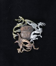 Dragons and Shield Brooch by PINSwithPERSONALITY on Etsy, $22.00