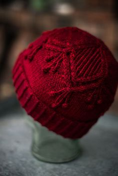 The Cherry Bobble knitting pattern is perfect for cozy fall and winter days. The pattern includes both written and charted knitting instructions. The cables and bobbles make this a fun and engaging knitting project for all levels of knitters!  #knit #knitting #knithat #cableknit Winter Knitting Patterns, Hat Patterns, Bobble Hats, Stockinette, Knitting For Beginners, Yarn Colors, Knitting Projects, Diy Clothes, Knitted Hats