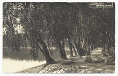Two women walk along a tree-lined path on the bank of the Neman River. Birstonas, date unknown. Photography by J. Skrinskos.