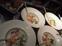 Adding shrimps, squids, clams and quail eggs to the pho