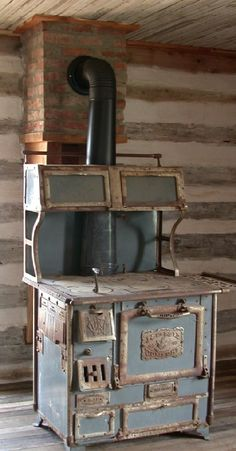 14 Cook Stoves from the Past. Grandma & grampas old cabin has a chimney setup just like this... now I know where the cook stove sat!