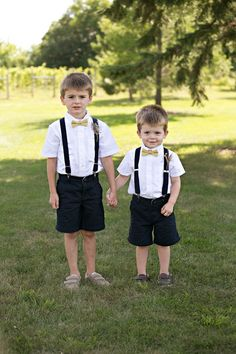 Shorts, suspenders and bow ties - could you think of a cuter ring bearer look for this relaxed Minnesota wedding? {Erin Johnson Photography}