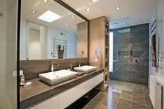 Awesome Bathroom Design In Elegant Home In Canterbury With Large Wall Mirror And Screened Shower At The Corner