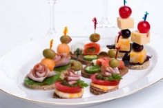 Assorted Canapes-sandwiches On Plate Over White Background With.. Royalty Free Stock Photo, Pictures, Images And Stock Photography. Image 914599.
