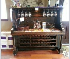 Great old piano turned wine rack!  Awesome idea :)