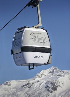 To accompany Chanel's seasonal pop-up shop in Courchevel the brand has installed these adorable cable-cars featuring signature sketches by Karl Lagerfeld.
