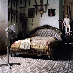 Bed, Crosses and a Fan.