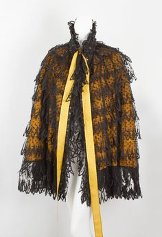 "Beaded Black Lace Cape, Lined With Gold Silk Satin, Hem Foinished With A Wide Fringe Of Jet Black Beads - Label Reads ""Emile Pingat/30, Rue Louis le Grand 30""    c.1880-1890  -  Vintage Textile"