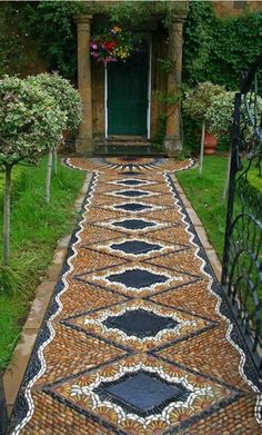 DIY a gorgeous pathway.  Basic instrructions are here but no pattern, only the photo. I'm not brave enough to do this entire project, but a small area would be awesome and just as beautiful!
