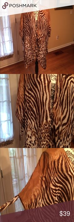 Chico's animal print Duster. One Size. NWOT Chico's lightweight viscose animal print Duster. Light, airy and comfortable. All soft viscose. One size. NWOT Chico's Other