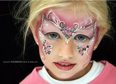 Butterfly face paint by artist Lynne Jamieson. Love the unique technique used here.