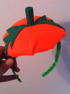 DIY pumpkin head band for Halloween/ costume accessory. All you need is a hair band, circular piece of cardboard, green & orange felt, a plastic bag or tissue paper for stuffing, and a glue gun! By S. Craddock