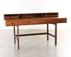 Denmark 1960's This is the classic flip top Rosewood desk designed by Jens Harald Quistgaard. It folds out to more than 37″ deep.