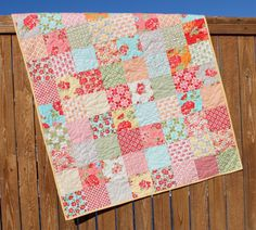 """This adorable baby quilt was made by two friends who love to quilt together. We created the quilt with Bonnie & Camilles """"Marmalade"""" fabric line"""