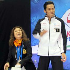 Daisuke Takahashi exults in the kiss-and-cry area after winning 2010 Skate America.