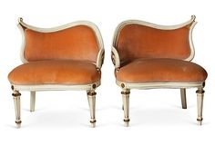 Pair of 1930s highly decorative Hollywood Regency-style salon chairs with ivory finish and gold-painted metal accents. Peach velvet upholstery.