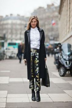 Metallic floral pants with boots and long coat. Appropriate for work yet showcasing a chic city look.