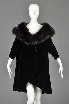 Mr Blackwell 1960s Velvet + Fox Fur Tapered Swing Coat | From a collection of rare vintage jackets at https://www.1stdibs.com/fashion/clothing/jackets/