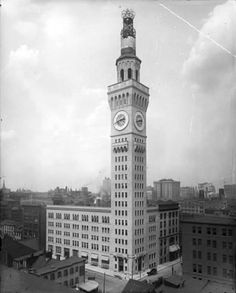 "BROMO SELTZER TOWER.  Modeled after a Venetian clock tower. Today housing artist galleries. The tower is approx. 290"" tall and is shown here, as originally adorned, with a 51' tall glowing blue, rotating Bromo-Seltzer bottle. Due to structural concerns however, the bottle was removed in 1936.   Baltimore, Maryland."