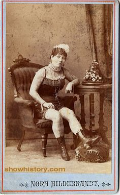 Nora Hildebrandt at age 22 became the first tattooed woman to be exhibited in America.