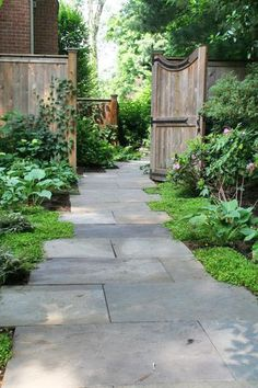 Fritz & Gignoux | Landscape Architects - staggered stone path to side garden