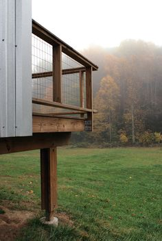 Farmhouse I Dwell Magazine - outdoor spaces/railing for screened in porch + adding some more galvanized steel?