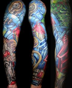 was never into biomech tattoos until i saw this...amazing work