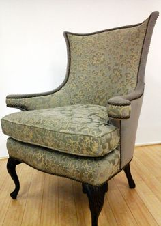 Antique chair reupholstered in two complimentary fabrics with nail head trim.  Reupholstered by Blawnox Upholstery