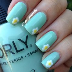 Turquoise nails with an elegant bit of decor - small nail art daisies - can be done using a nail dotting tool or even just a cocktail stick!  Perfect for spring and summer months ♥