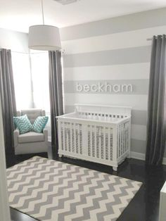 Light gray and white striped walls with darker gray curtains.