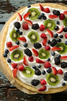 Dessert pizza with sugar-cookie crust, frosting, whipped cream and fresh fruit.