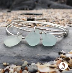 Saltwater Souls by Sea Gypsy. A handmade hammered sterling silver 925 bangle decorated with a beautifully unique piece of seafoam coloured sea glass collected from the North Devon coast.