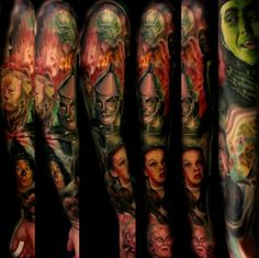 An entire sleeve Tattoo by Christopher Bettley #inked #tattoo #sleeve #dorothy #scarecrow #wizard #oz #witch #tinman #monkey #lion #arm #ink