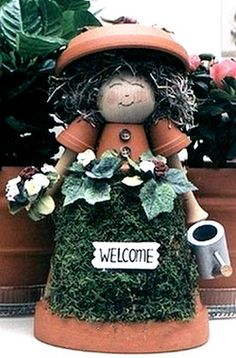 Make adorable Mrs Gardener figurine from clay pots, and add a tiny watering can, flowers and moss as decorations.