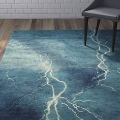 Features:  -Material: Viscose.  -Power loomed.  Rug Shape: -Rectangle.  Technique: -Power Loom.  Primary Color: -Turquoise, ivory.  Product Care: -Professionally cleaned.  Product Type: -Area Rug.  Ma