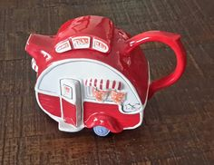 What a cute little red tea kettle trailer? It will be awesome if you can find the matching red tea cup.