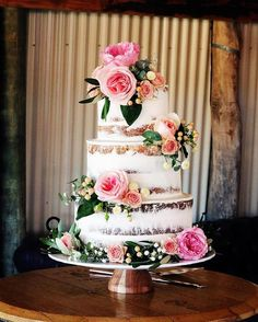 Wedding Cakes Love this cake. You can see that the bottom tier is a different flavour cake from the top two tiers. The arrangement of the flowers is stunning. Imagine altering the colours to compliment the nautical theme and you have a cake of true beauty.