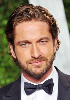12 Brushed Back Hairstyles for Men: Gerard Butler has it under control