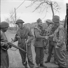 Allies in battle: British troops and American Rangers meet on the Anzio-Rome road, Italy, 23 January 1944. Throughout the war, British and American fought side by side with a high sense of camaraderie and mutual appreciation.