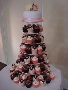 Black, white & a hint of pink wedding cupcake tower by Angelina Cupcake, via Flickr