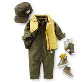 Olive coveralls and a bright yellow vest are a perfect outfit for exploring. High top sneakers and a camo hat keep him in top shape.